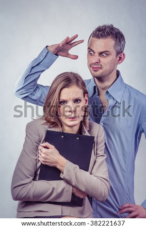 Angry boss scold and threaten with his employer woman and she is surprised and shocked - stock photo