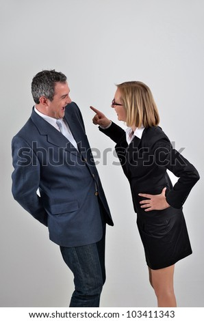 Angry boss shouting at her staff - stock photo
