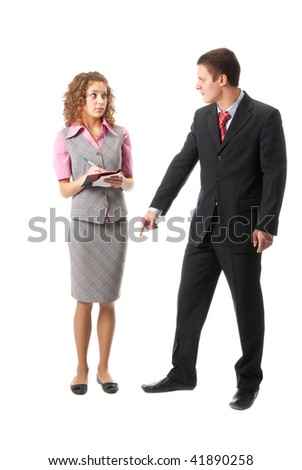 Angry boss unhappy with the work of secretaries - stock photo