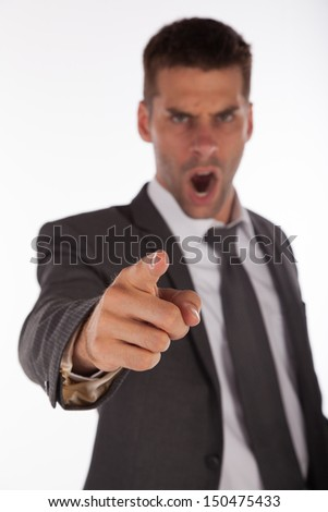 Angry boss yelling and pointing finger. Focus on the hand - stock photo