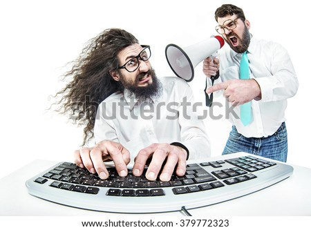 Angry boss yelling to a stressed office worker - stock photo