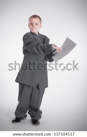Angry boy in a big jacket shows on paper - stock photo