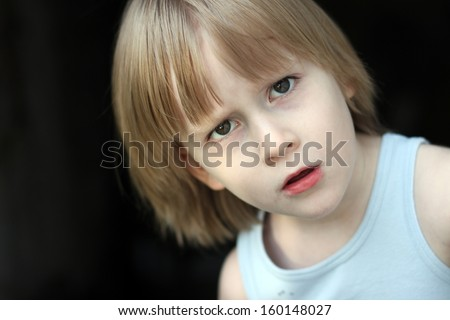 Angry boy portrait - stock photo