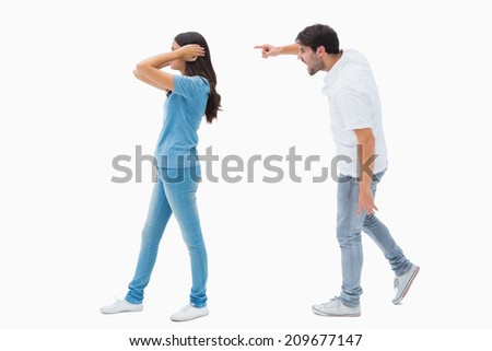 Angry boyfriend shouting at girlfriend on white background - stock photo