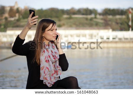 Angry business talk on mobile phone - stock photo
