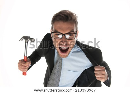Angry businessman about to hammer on white background. closeup of angry and fierce looking mature guy with hammer - stock photo