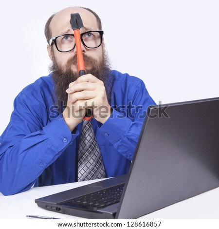 Angry businessman and hammer - (Series) - stock photo