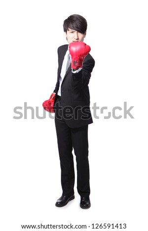 angry businessman arise arm with boxing gloves in full length isolated over white background, asian model - stock photo
