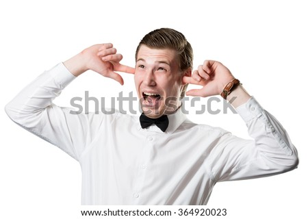 Angry businessman covering his ears isolated on a white background - stock photo