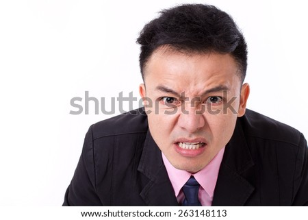 angry businessman grinding his teeth, looking at you - stock photo