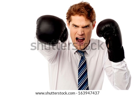 Angry businessman ready to punch you - stock photo