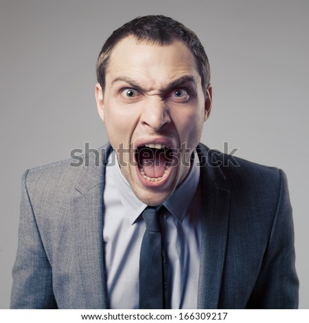 Angry Businessman Screaming - stock photo