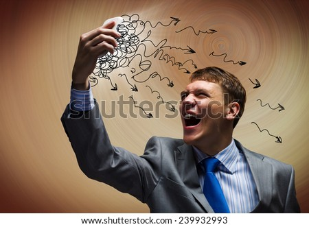 Angry businessman screaming furiously in mobile phone - stock photo