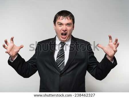 Angry businessman screaming very loud - stock photo