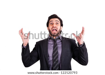 angry businessman screaming with his arms raised - stock photo