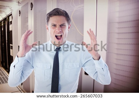 Angry businessman shouting against data center - stock photo