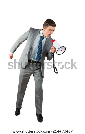 Angry businessman shouting through megaphone on white background - stock photo