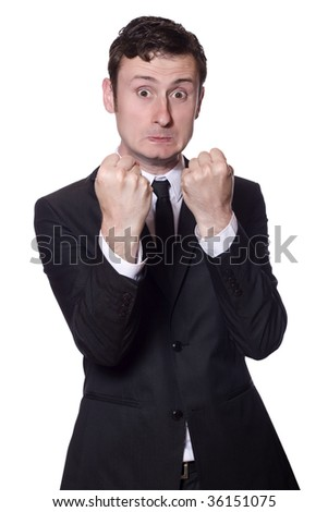 angry businessman showing boxing gesture on an isolated white background - stock photo