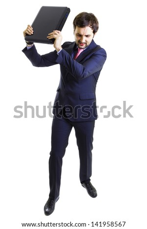 Angry businessman throwing a laptop, isolated on white, full lenght. - stock photo
