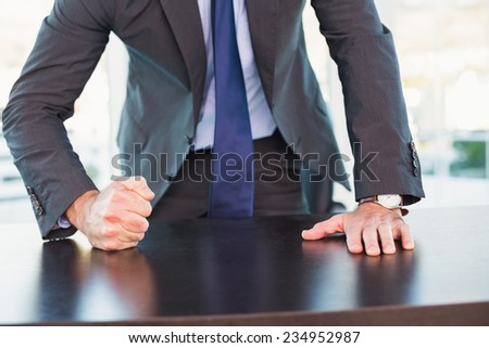 Angry businessman thump the table in his office - stock photo