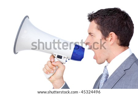 Angry businessman yelling through a megaphone at the office - stock photo