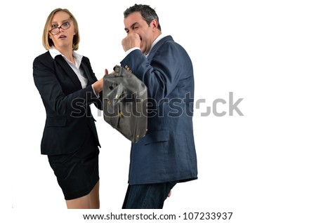 Angry businesswoman is hitting across the businessman - stock photo