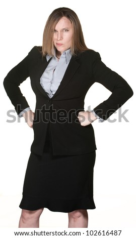 Angry Caucasian business woman with hands on hips - stock photo