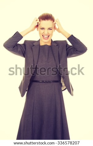 Angry caucasian businesswoman screaming loud. - stock photo