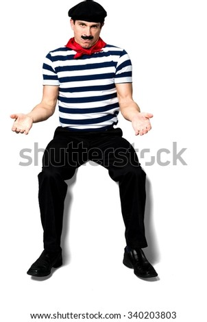 Angry Caucasian man with short black hair in costume with hands open - Isolated - stock photo