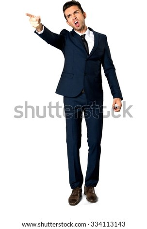 Angry Caucasian man with short dark brown hair in business formal outfit arguing with person - Isolated - stock photo