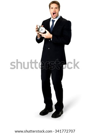 Angry Caucasian man with short medium blond hair in business formal outfit holding alarm clock - Isolated - stock photo