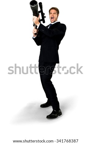 Angry Caucasian man with short medium blond hair in business formal outfit using bazooka - Isolated - stock photo