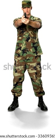 Angry Caucasian Soldier In Green Camouflage Uniform aiming with handgun - Isolated - stock photo