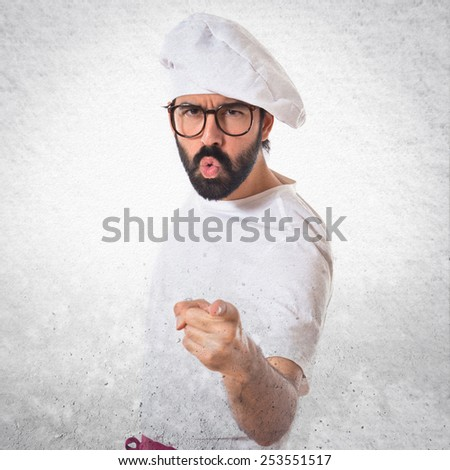 Angry chef shouting over white background - stock photo