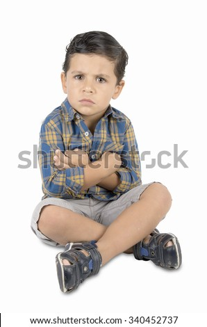 angry child sitting on the floor. on white background - stock photo