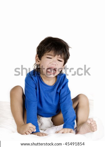 Angry crying disabled toddler boy with cerebral palsy  sitting, isolated on white - stock photo