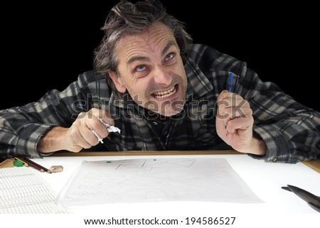 angry designer with no idea at work on light box - stock photo