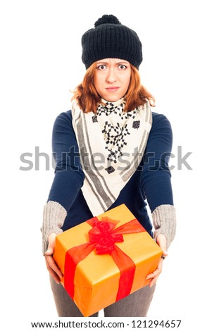 Angry disappointed woman holding gift box, isolated on white background. - stock photo