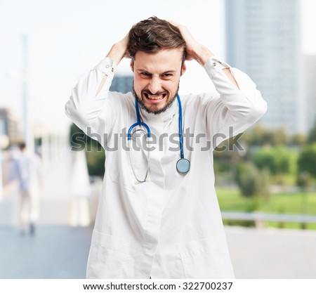 angry doctor man stressed - stock photo