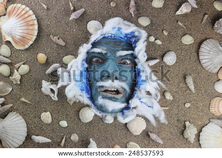 angry face expression, blue sea concept - stock photo