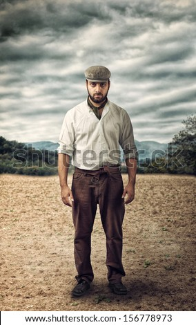 Angry farmer on a empty land. - stock photo