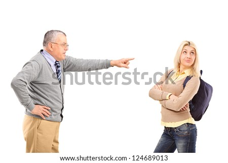 Angry father reprimanding his daughter isolated on white background - stock photo