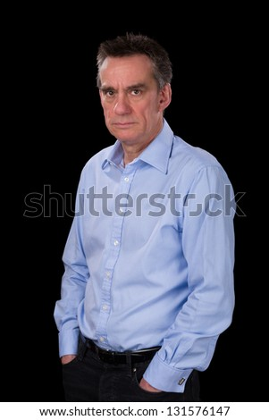 Angry Frowning Middle Age Business Man in Blue Shirt Black Background - stock photo