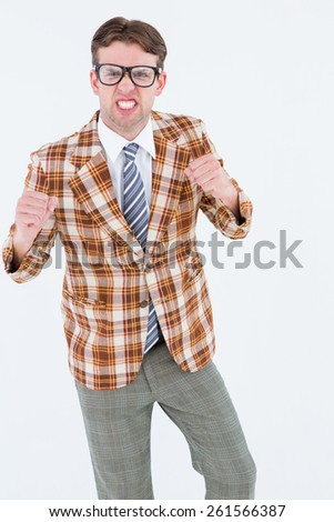 Angry geeky hipster looking at camera on white background - stock photo