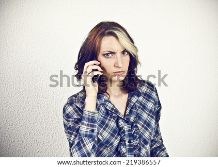 Angry girl at smart phone  - stock photo