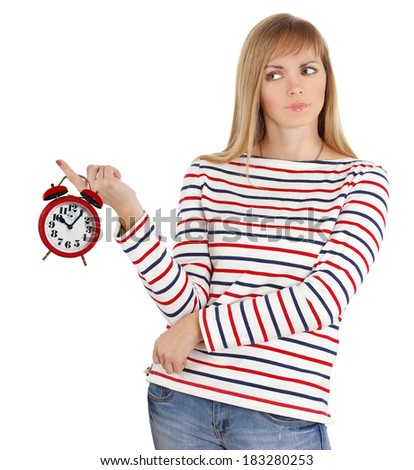 Angry girl with alarm clock. - stock photo