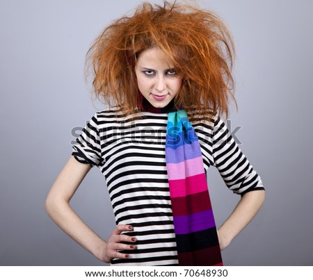 Angry girl with funny hair. Studio shot. - stock photo