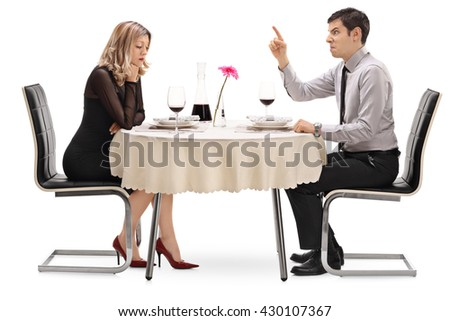 Angry guy yelling at his girlfriend and threatening with his finger isolated on white background - stock photo