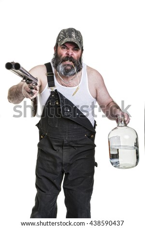 Angry hillbilly with shotgun and moonshine on a white background. - stock photo
