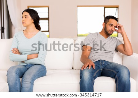 angry indian couple having conflict at home - stock photo